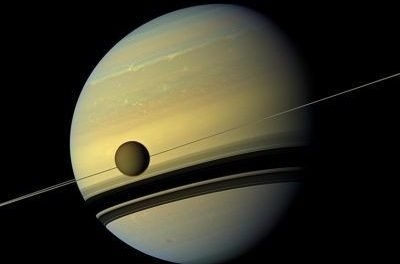 Brightness of Saturn's largest Moon Titan provides new tool to study mysterious exoplanets