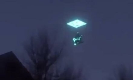 Bizarre sight of 'UFO' disappearing into portal seen across the globe