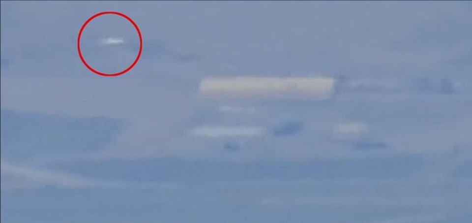Mysterious white 'flying saucer' filmed hovering over Area 51 near giant new aircraft hangar