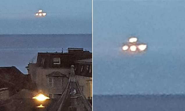 Moment student captures 'large UFO' hovering over Devon seafront at night 'for ten seconds' | Daily Mail Online